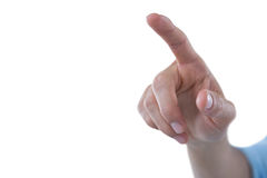 Hand of man pretending to touch an invisible screen. Against white background Royalty Free Stock Image