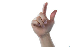 Hand of man pretending to touch an invisible screen. Against white background Stock Photo