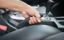 Hand man pull hand brake Stock Image