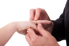 Hand of a man putting a ring on the hand of woman Stock Photo