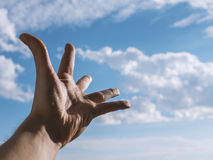 Hand of a man reaching to sky. Hand of a man reaching to towards sky. Color toned image. Selective focus Stock Photos