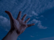 Hand of a man reaching to sky. Hand of a man reaching to towards sky. Color toned image. Selective focus Royalty Free Stock Photos