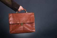 Hand man with a red briefcase. Stock Images