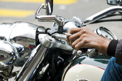 Hand man ride motorcycle and smoking at the same time Stock Images