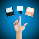 Hand man show diskette vintage memory on blue backgrond Stock Photo