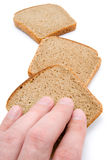 Hand of man and slices of bread. Isolated royalty free stock images