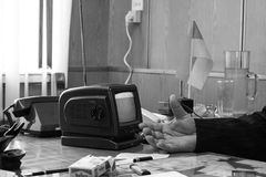 Hand of man with a small TV. Kamin, Volyn / Ukraine - October 06 2008: Hand of man with a small TV in the office Stock Photo