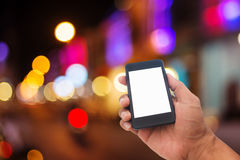 Hand man with smart phone mobile on night city Stock Images