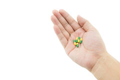 A hand of a man with some capsule pills on white background Stock Images