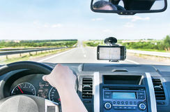 The hand of man is on the steering wheel and gps is on the winds Stock Photo
