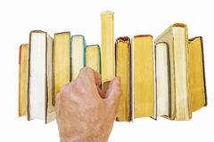 Hand of man takes book from shelf isolated on white Stock Photography