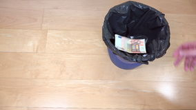 Hand of man throw cash euro money banknotes in can bin. 4K stock footage