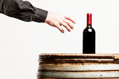 Hand of a man about to grasp a wine bottle. Male hand about to grasp a wine bottle Stock Images
