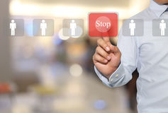 Hand of a man touching red modern button pressing in concept stop to work business technology and have male icon. Hand of a man touching red modern button stock images