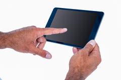 Hand of man touching tablet computer Royalty Free Stock Images