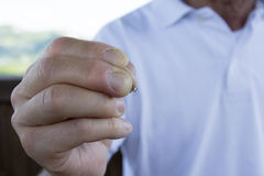 Hand man and tweezers Stock Photo