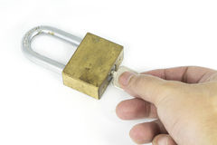 Hand man un lock the key on white background Stock Photography