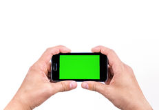 Hand  of man use mobile smart phone for shot a photo with chroma key green screen Stock Image