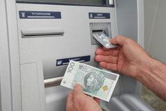 Hand of a man using banking machine Stock Image