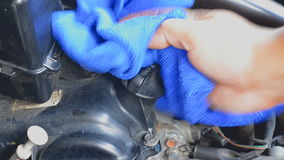 Hand of man using blue micro fiber fabric to clean car stock footage