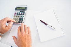 Hand of man using a calculator Stock Photography