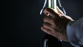 Hand man using corkscrew to open a bottle of wine. Black background. Hand man using corkscrew to open a bottle of wine stock video footage