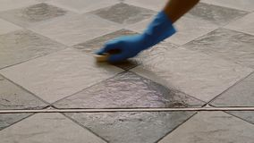 Cleaning the tile floor stock video footage