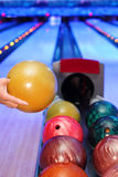 Hand of man, which takes ball for throw in bowling Royalty Free Stock Image