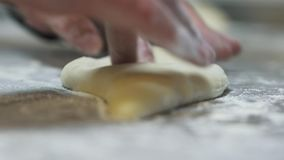 Male hand working with dough close up. Chef preparing khachapuri Georgian cheese pie with egg. Tasty dish making in cafe stock video