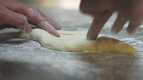 Hand of man working with dough close up. Chef preparing khachapuri Georgian cheese pie with egg. Tasty dish making in stock footage