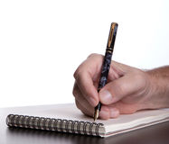 Hand of a man writing. With a fountain pen royalty free stock photos