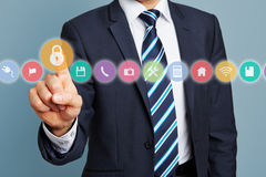 Hand of manager pressing lock icon Stock Image