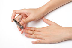 Hand manicure with nail clipper Royalty Free Stock Images