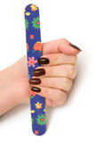 Hand with a manicure and nailfile. Object on white - female hand with a manicure Stock Photo