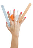 Hand with manicure tools Royalty Free Stock Photography