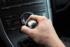 Hand on manual gear shift knob. Close up of hand on manual gear shift knob royalty free stock photo