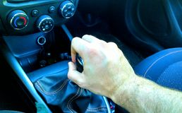 Hand on manual gear shift knob. White male hand view close up stock images