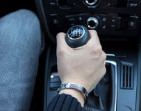 Hand with manual gear shift lever. Close up royalty free stock photography