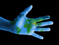 Hand with map of the world Stock Photos