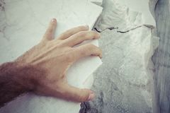 Hand on marble Stock Image