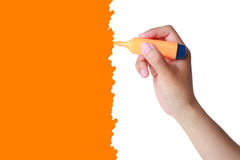 Hand with marker drawing an orange background Stock Photography