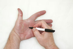 Hand and marker. A male hand writing. A marker on the other hand. With a place under the text. Photo for your design Stock Photography