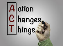 Hand with marker writing Action Changes Things (ACT), business c Stock Image