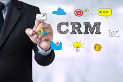 Hand with marker writing: CRM Stock Photos