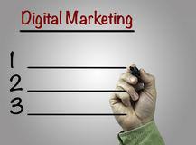 Hand with marker writing Digital Marketing, business concept Royalty Free Stock Images