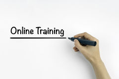 Hand with marker writing: Online Training Stock Images
