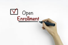 Hand with marker writing: Open Enrollment.  Stock Images