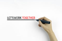 Hand with marker writing the text - Let's work together Royalty Free Stock Photos