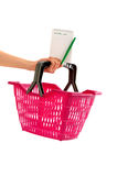 Hand with market basket and blank shopping list. Stock Photography