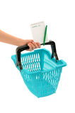 Hand with market basket and blank shopping list. Stock Photo
